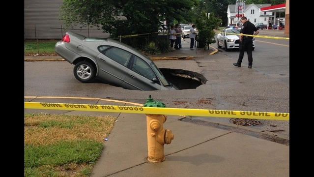 Sinkhole Swallows Car on North Main