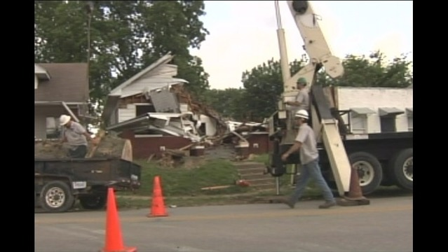 Crews Begin Removing Tree from Evansville Home