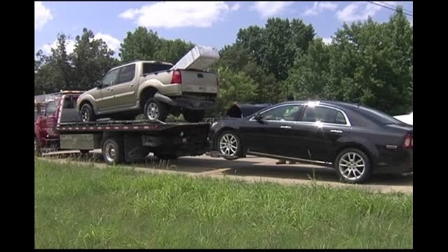 Car Crashes into Stopped Truck on I-164.