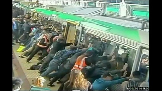 'People Power' Saves Man Trapped Between Train and Station