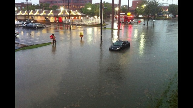 Drivers Deal with Flood Waters after Heavy Rain