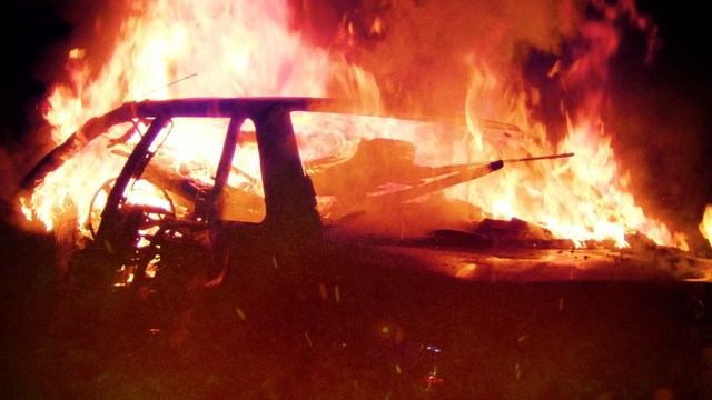 Unoccupied Car Engulfed in Flames Near Spottsville