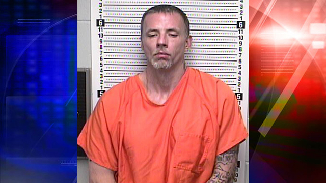 Police: man tried to enter two houses, found hiding in car