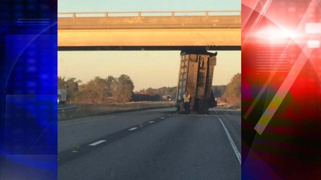 update traffic down to one lane after truck gets wedged under overpass